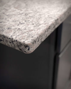 Counter edge detail over CNC Luxor island cabinets in Smokey Grey kitchens at Residences On Main in Bristol.