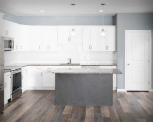 Residences On Main kitchen with CNC Luxor perimeter cabinets in White and Island in Smokey Grey.