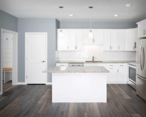 Residences On Main kitchen with CNC Luxor perimeter cabinets and island in White.